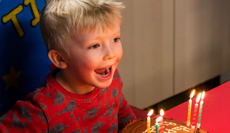 toddler celebrating with a birthday party